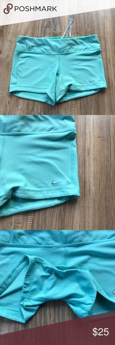 Tiffany blue Nike spandex running shorts NWOT Bought these for my daughter for volley ball and she never wore them in excellent condition Nike Shorts