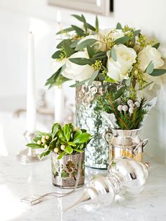 Master Bath Details - Mercury glass vessels filled with white roses and greenery artfully top the marble vanity in the master bath.