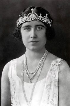 1923: The 23-year old Queen Consort (later known as the Queen Mum) wearing the pearl and diamond necklace which was a wedding gift that year from the citizens of London.