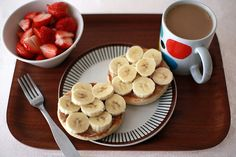 healthy breakfast! 1 cup strawberries, toasted bagel thin w/natural peanut butter, 1 sliced banana, 1 cup coffee w/milk