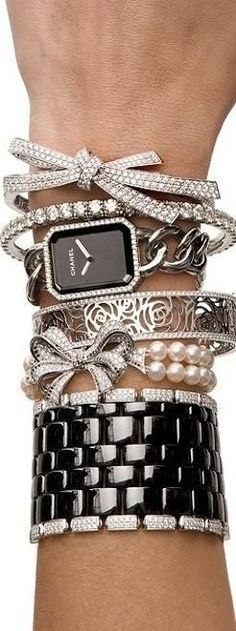 Chanel. Stacked bracelets, bangles, cuffs, watch.