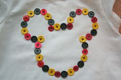 Here is a super easy and simple shirt I made for my girls before our Disney trip.  Mickey shirts made with buttons.  First you need a mickey...