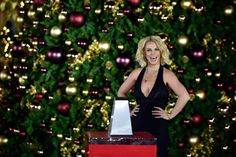 Pin for Later: See How the Stars Are Celebrating the Holiday Season!  Britney Spears was given the honor of flipping the switch at a Christmas-tree-lighting ceremony at The LINQ Promenade in Las Vegas in November.