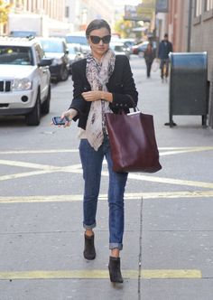A scarf is an easy way to amp up your day to day; then do like Miranda Kerr and swap out your flats for booties to really hit that street-chic edge.