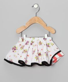 A reversible print allows this skirt to be worn inside out. Pin tucks under the elastic waistband give way to a full design that's comfy for girls as they twirl the day away.65% polyester / 35% cottonMachine washMade in the USA