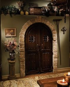 interior doors. these could be entrance to a basement wine cellar.