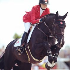 Tiffany Foster (Canada) and Tripple X III in complete concentration as one unit during their Show Jumping event.
