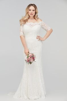 Savannah | Wtoo by Watters - Lace, sheath wedding gown features an off-the-shoulder neckline and lace sleeves. Sampled in size 24, its the perfect full-figured, curvy bridal gown.