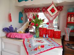 The tiny kitchen in Melissa's camper has the cutest vintage accessories.