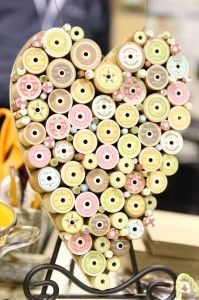 I could get a heart-shaped wood cutout, put nails on it, and hang spools on the nails! Useful art!!