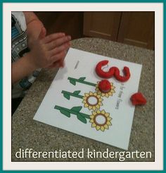 FREE awesome early in the year center...back to school center with play doough!  A Differentiated Kindergarten: Differentiated Math Stations For The Beginning of The Year and A Couple Of Freebies!