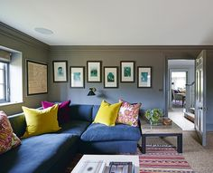 """""""I love to make displays of family photographs,"""" says Stephanie of the staggered arrangement in this room. Home of interior designer Stephanie Dunning of Dunning Designs. Homes & Gardens. Photograph by Jonathan Gooch. http://www.hglivingbeautifully.com/2016/02/17/hg-house-tours-a-stunning-victorian-family-home-in-wiltshire/"""