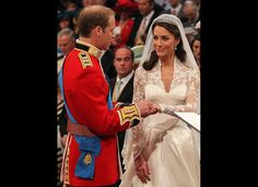 The couple exchanging rings at their ceremony. To see more great Royal Wedding Shots and Pictures of Kate and William visit: http://stillblondeafteralltheseyears.com/category/kate-and-williams-wedding/