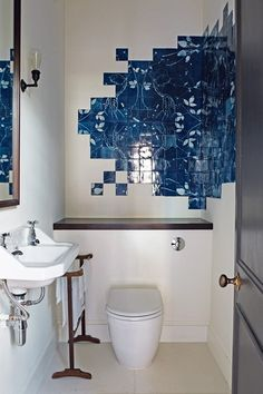 Discover small bathroom design ideas on HOUSE - design, food and travel by House & Garden. Be inspired by these unusually-made bathroom tiles in a London home designed by Ebba Thott.