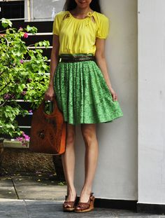 my yellow! love the skirt's silhouette. purse & footwear - meh!