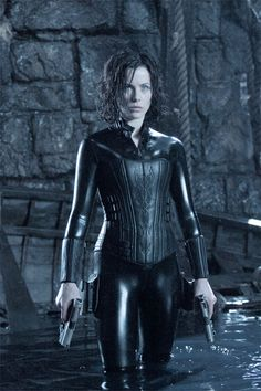 Kate Beckinsale in a tight rubber/leather/vinyl/'whatever' suit! Nuff' said. Check out our sexy spooky sale for 25% off . www.shelbymason.com #bootights #sexyspooky
