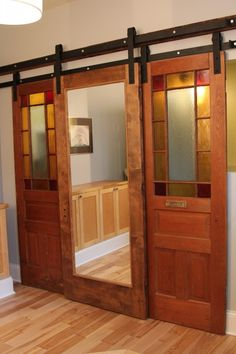 Interior Sliding Wooden Barn Style Door Featuring Mirror
