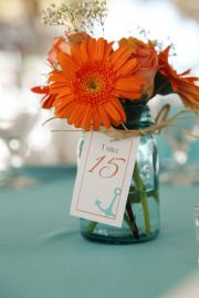 I like two things in the design besides the mason jar, the jute twine, and the table number.