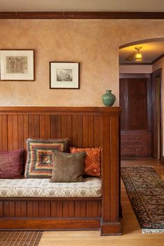 The original bench of beaded boards welcomes visitors in the front hall.