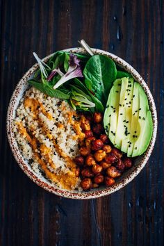 AVAILABLE M - F This vegan buddha bowl has it all - fluffy quinoa, crispy spiced chickpeas, and mixed greens, topped with a mouthwatering red pepper sauce! Serves 2