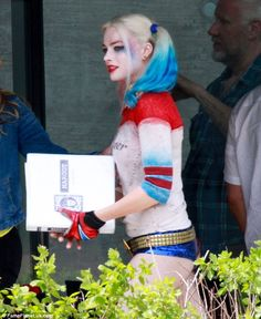 Riding high: Margot Robbie certainly has a cheeky costume for her latest role in the film Suicide Squad - she showed off a pair of tiny hot pants while on set in Toronto, Canada on Monday