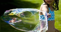 Ever wondered how to make gigantic bubbles? Learn how to make a large bubble wand and proper bubble solution for blowing gigantic sized bubbles! Fun for the whole family ... try it 4th of July at your family picnic! http://ziggityzoom.com/activity/make-giant-bubbles-solution-and-how