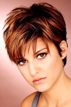 Choppy layered cut, copper-red color.  This is the cut I would want if I ever go with short hair again