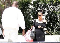 Stepping out: Kim Kardashian shows off her trim waitline in black as she enjoys some family time with Kanye West and North in Brentwood, California on Saturday