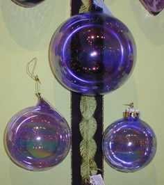 purple Jim Marvin blown glass laser balls