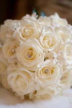 white roses. add some silver eucalyptus and more rhinestone stems with black ribbon.. love this very pretty