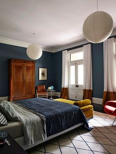 The Avenue by Arent&Pyke | HomeAdore | Deep Airforce blue walls, Geometric rug and mustard daybed - lovelyv
