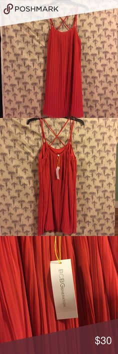 Brand new never worn BCBG dress. It's almost a coral colored dress very very pretty. I bought for a wedding and decided to wear a different one. New with tags. Never worn. BCBG Dresses Mini