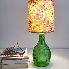 Make lamps from old bottles. Would definitely need a different style shade.
