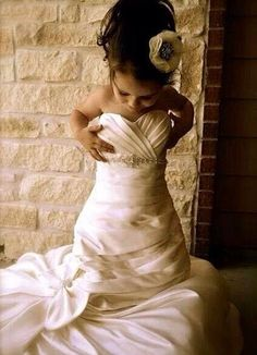 Every little girl should be photographed in her mom's dress :)