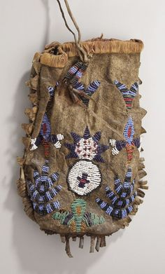 A SIOUX BEADED HIDE POUCH. c. 1890... American Indian ArtBeadwork   Lot #78029   Heritage Auctions