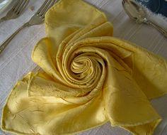 """""""rose"""" folded napkin."""