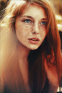 Character: Grace Penelope Salina from the Absent Stars, with blue eyes and fiery red hair.