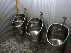 Fabulous recycling: old beer kegs repurposed as urinals at Monteith's Brewery, New Zealand.