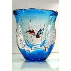 murano glass aquarium vase Please consider investing in real estate.  The time is now and the return is very rewarding. Call: Steve OBryan