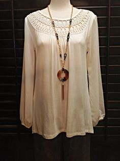 August Silk  - Cream tunic with crochet neckline and chiffon sleeves  - $60