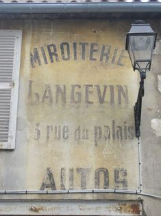Antique French wall lettering