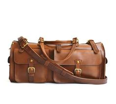 AVAILABLE IN TOBACCO Ready to escape for a few days? Whether it's a road trip or you're flying to your destination the Marlondo Leather Weekender Duffle Bag will allow you to travel in comfort and style. It's easy to pack, easy to carry, and looks fantastic.
