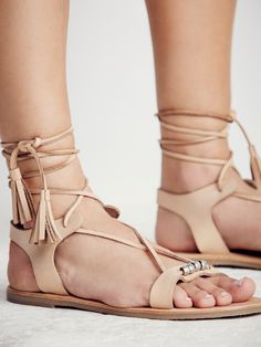 Bryn Marr Wrap Sandal | These easy boho sandals are featured in a soft leather with subtle metal bead accents. Adjustable statement wrap ties. Rubber treaded soles.