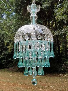 A very pretty vintage glass chandelier with light aqua crystal water drops. The metal pieces have been painted robins egg blue and ocean mist to make this fixture even prettier! Measures 8 in diameter and 18 long. More information on the way...
