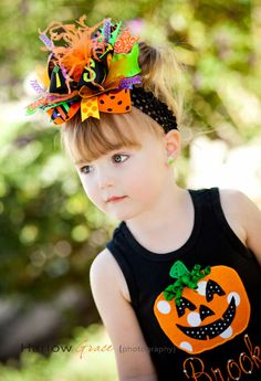 http://www.pretty-princess-bowtique.com/item_280/Spooky-Halloween-Over-the-Top-Hairbow-Headband.htm
