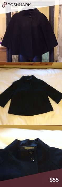 """*SALE* Ann Taylor Black Jacket SALE! Cute Ann Taylor black cape/pea coat style jacket with half length sleeves. 3 button closure...2 at top at neck & one hidden inside just below the other 2. Rayon/wool blend. Total length from top of collar...22.5"""" Sleeve length not including collar...18.5"""" PERFECT CONDITION! Ann Taylor Jackets & Coats"""