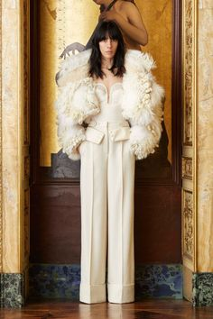 Roberto Cavalli served up the statement coat of our DREAMS with this whimsical feathered piece during Milan Fashion Week.