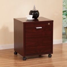 Collin Single Equipment Trolley / File Cabinet Color: Mahogany by Enitial Lab. $82.43. IDI-12506 Color: Mahogany Features: -Materials: Medium fiber board, veneer, plastic, metal.-Simple designed equipment trolley features a large spacious file cabinet compartment.-Right hand side lock with accessible key. Includes: -Includes bars to hang office files. Color/Finish: -Finish: Matte.-Silver finished drawer handle in center. Dimensions: -Internal file cabinet dimension: 16' ...