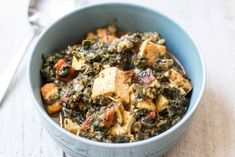 Pressure Cooker Saag Tofu! Super-quick, vegan version of the classic Indian spinach dish. Made with frozen spinach, canned tomatoes, tofu, coconut milk, and spices. #InstantPot #PressureCooker #GlutenFree #Vegan #EasyDinner #IndianFood