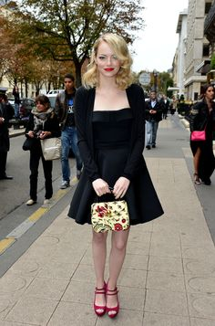 Emma Stone arrives at the Miu Miu Spring/Summer 2013 show as part of Paris Fashion Week on October 3, 2012 in Paris, France